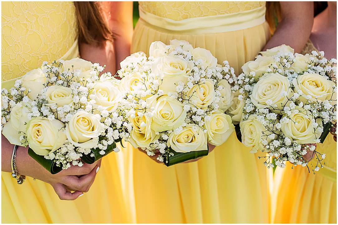 Bridesmaids yellow bouquets all together