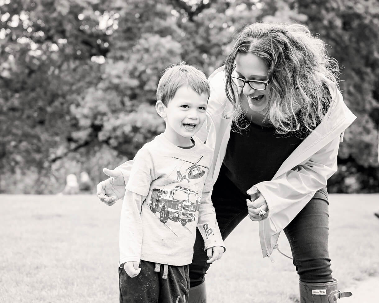 mum and Little boy playing in the park