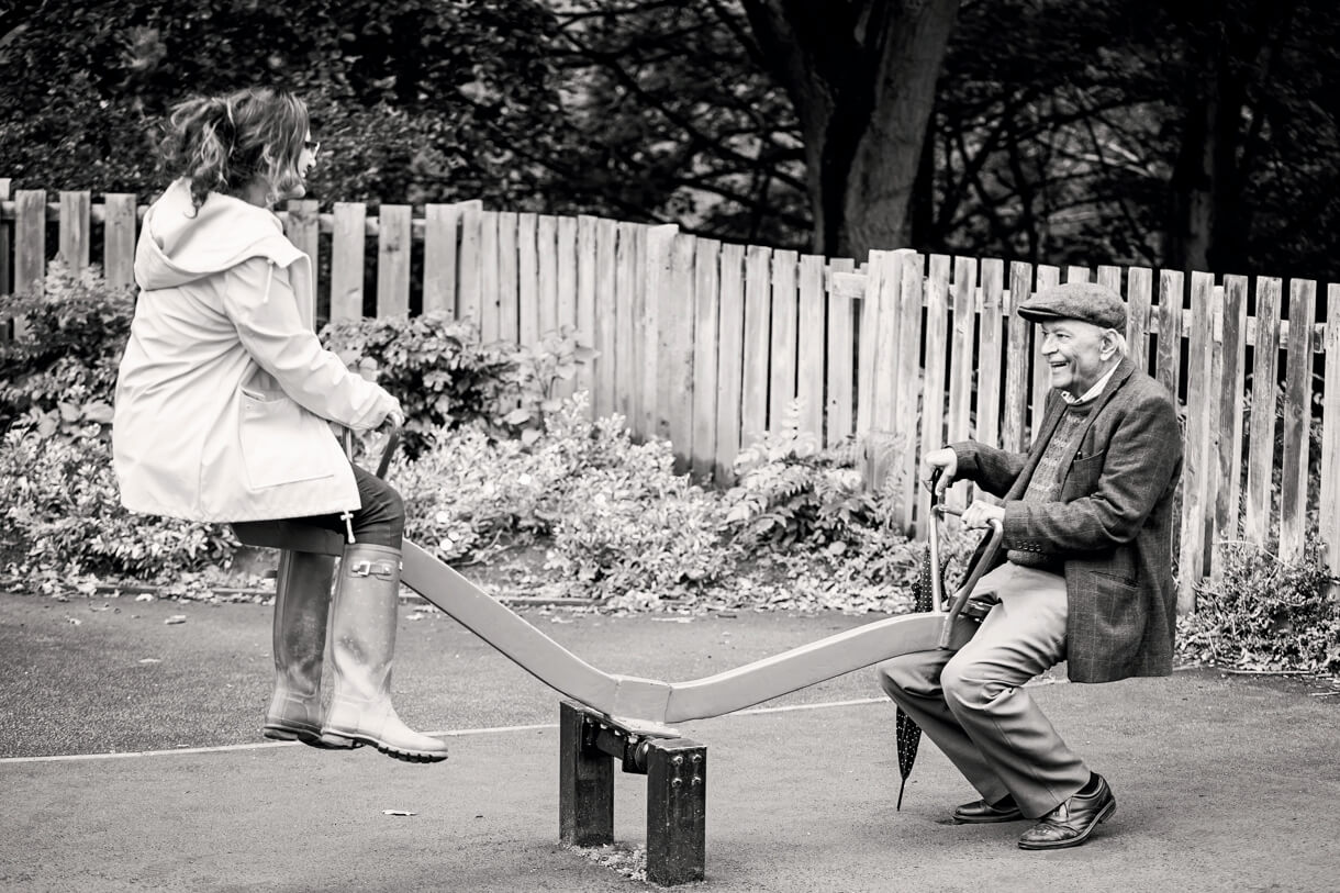 dad on the seesaw with his daughter