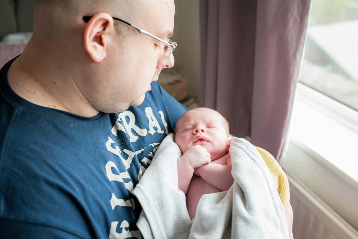 dad looking at baby boy