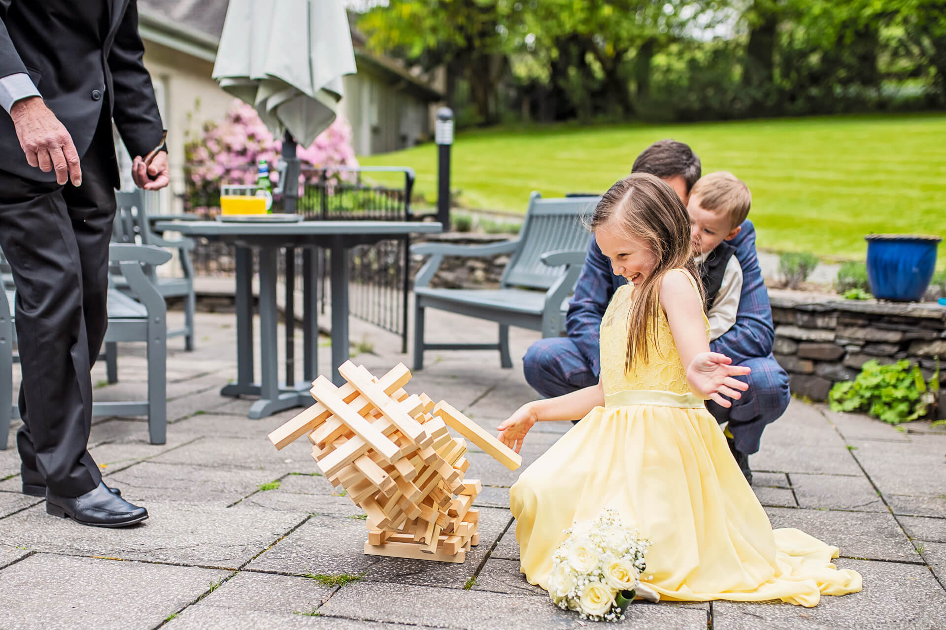 Little bridesmaid playing with jenga