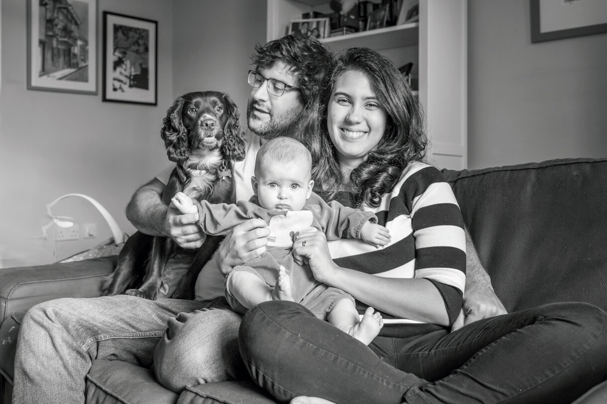 black and white image of the whole family plus the dog