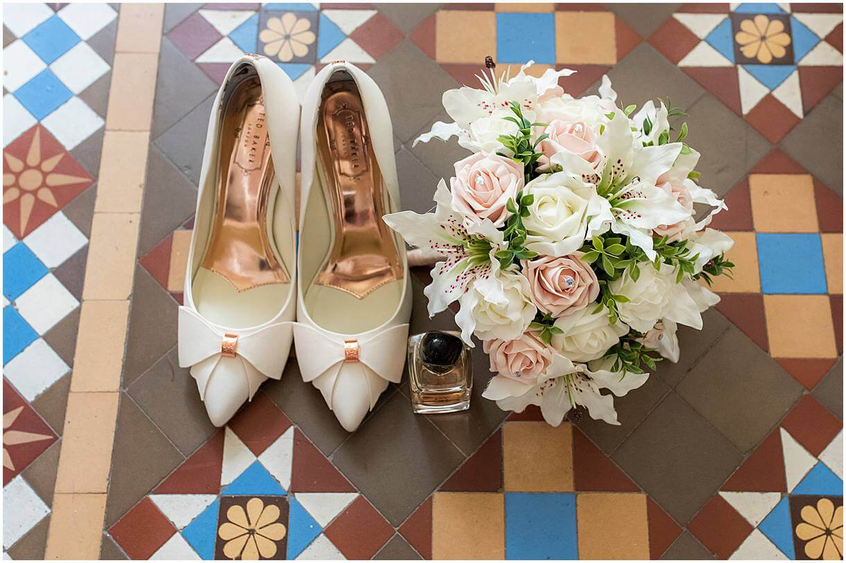 The brides shoes with the bouquet at pridal prep