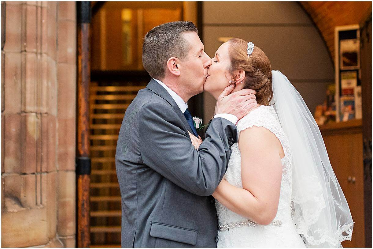 Bride and groom kissing on their Portrait shoot