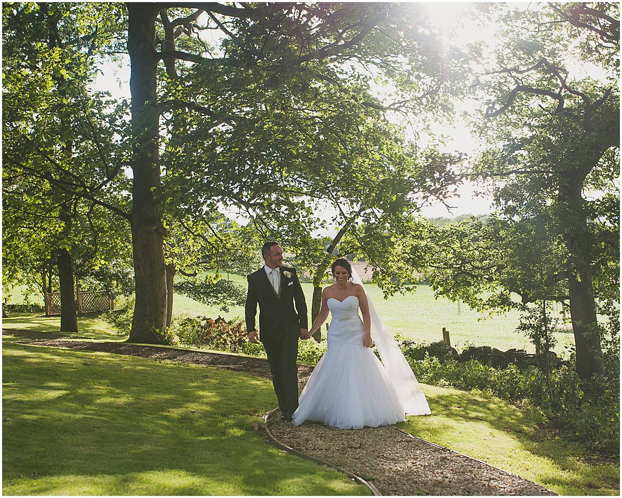 Bride and groom walking in the grounds of 315 Huddersfield