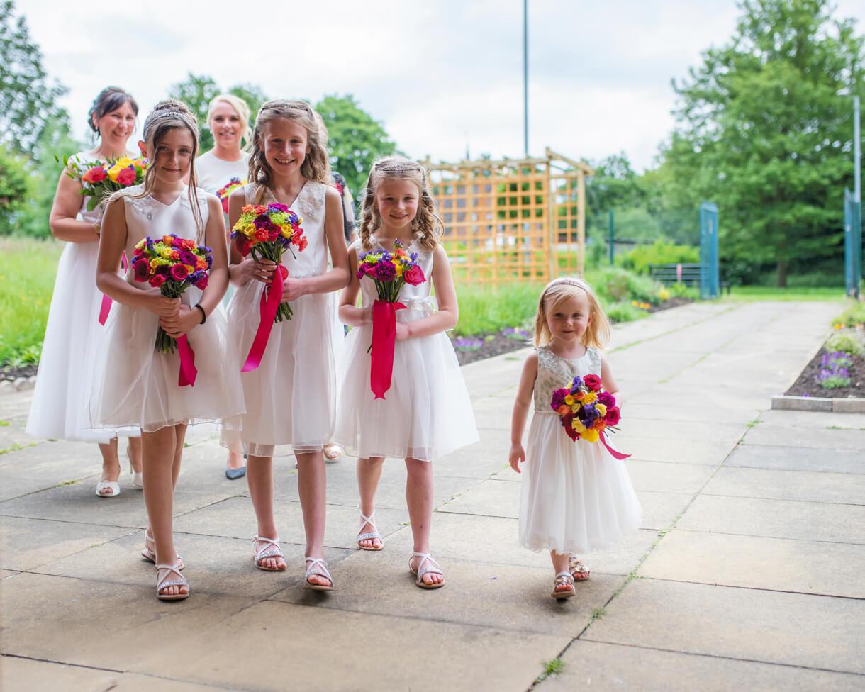 Bridesmaids walking into church